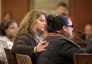 DAVID L. RYAN/GLOBE STAFF Erin Manning rubbed the back of domestic worker Sonia Soares during her testimony at the State House Tuesday.